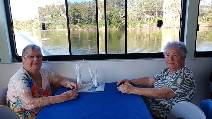 What a fantastic backdrop for this picture of passengers enjoying a Shoalhaven River Cruise