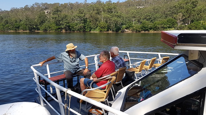 These passengers are enjoying some time on the Bow while their family and friends take a dip at Bangalee Reserve during a Private Charter with Shoalhaven River Cruise