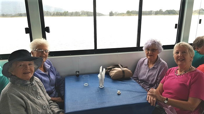 Enjoying a chat and the scenery, these passengers were happy for a 'happy snap' during a Shoalhaven River Cruise