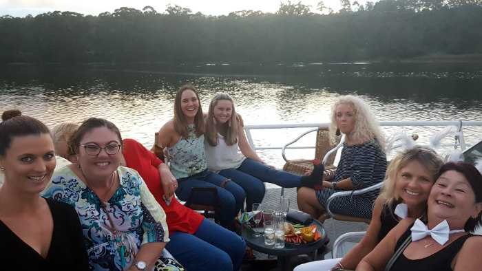 A great group of passengers enjoying a farewell cruise for two of their fellow employees onboard with Shoalhaven River Cruise