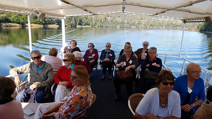 Happy passengers enjoying the smooth waters and sunny skies during a Shoalhaven River Cruise