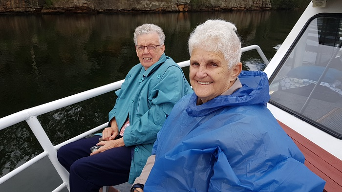 Even a damp day didn't dampen the spirits of these Shoalhaven River Cruise passengers enjoying some time on the Bow
