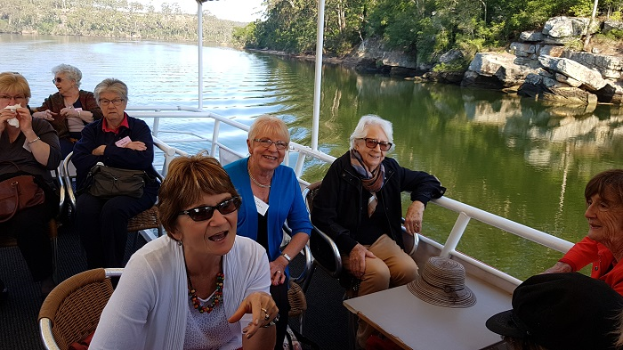 A gorgeous backdrop behind some fantastic passengers enjoying a Shoalhaven River Cruise