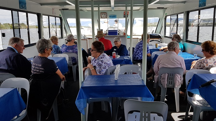 Lots of chatting going on amongst the passengers during a Shoalhaven River Cruise