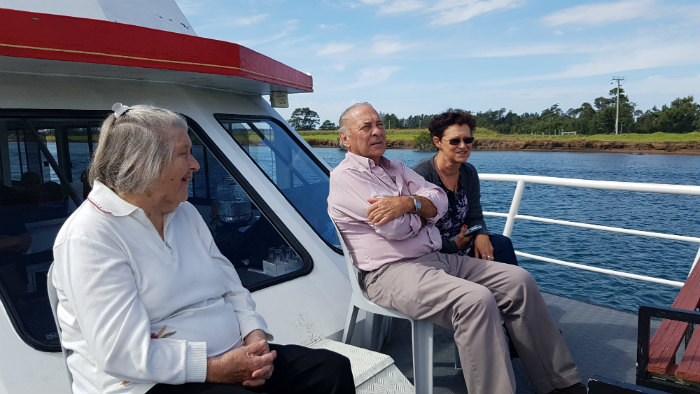 Relaxing and having a chat, these passengers are enjoying some time on the Bow of the Shoalhaven Explorer during a Shoalhaven River Cruise