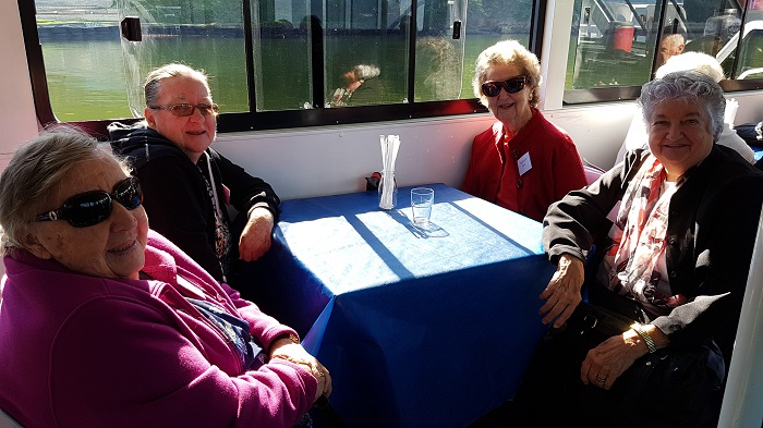 A group of passengers enjoying the sunshine during a Shoalhaven River Cruise