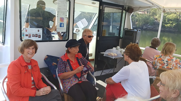 A happy group of passengers enjoying a sunny day for a Shoalhaven River Cruise